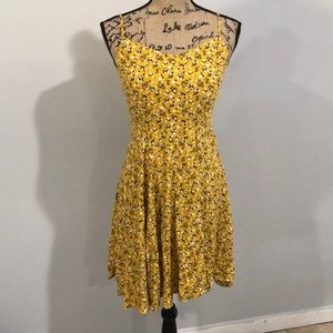 Sleeveless floral yellow above the knee dress